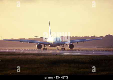 Commercial airliner at London Gatwick Airport runway, England, United Kingdom - Stock Image