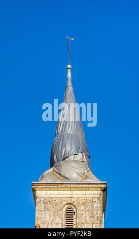 Tarpaulin covered church steeple (after lightning strike) - Boussay, France. - Stock Image