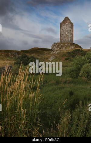 Smailholm Tower is a peel tower that stands around five miles west of Kelso in the Scottish Borders. Its dramatic situation, atop a crag of Lady Hill, - Stock Image