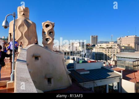 Barcelona, Spain, October 2018. Bright sunny morning for people visiting the roof of Antoni Gaudi's Casa Mila also known as La Pedrera. - Stock Image