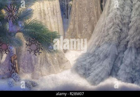 View of an elaborate Christmas display with artificial snow, pine tree and womens dresses in Rundle Mall, Adelaide in South Australia, Australia. - Stock Image