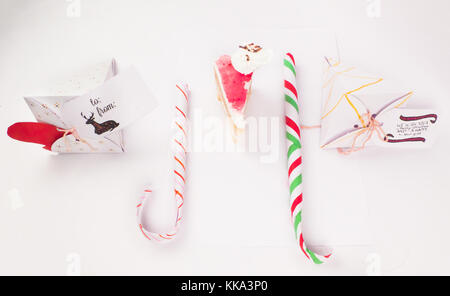 Flat Lay Style of Christmas Decoration with cake slice gift boxes with cake piece and confetti falling for best - Stock Image