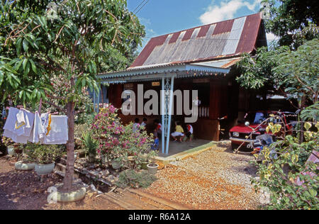 Malaysian house 02 with corrugated iron roof, 1975 vintage picture - Stock Image