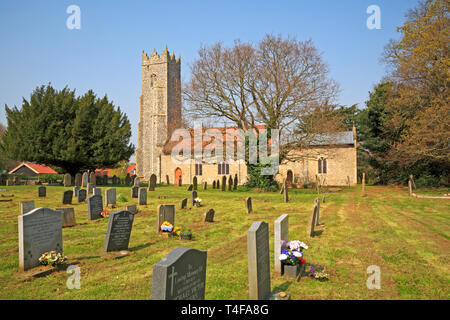 A view of the churchyard and parish Church of St Peter at Strumpshaw, Norfolk, England, United Kingdom, Europe. - Stock Image