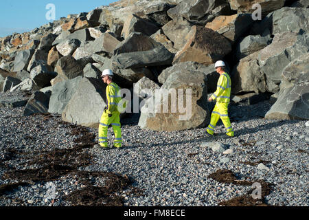 Stone brought by sea from Scandinavia  to form flood defences  at Borth upcoast from Aberystwyth on Cardigan Bay - Stock Image