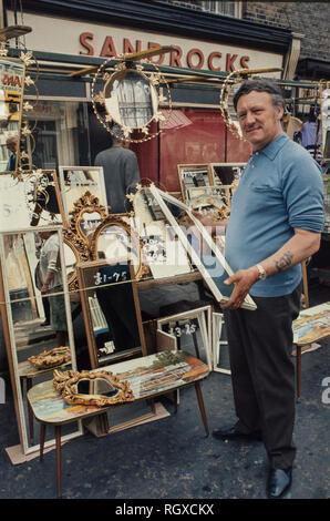 Market trader on Roman Road, Bethnal Green, London England,UK, 1974 George the Mirror Man. - Stock Image