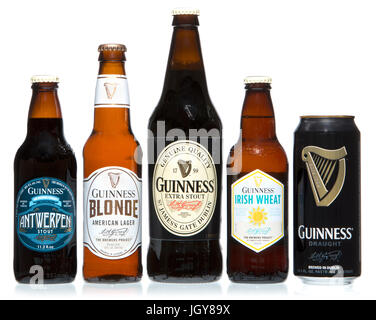 Various Guinness products including Draught (14.9oz), Antwerpen (11.2oz), Irish Wheat (12oz), Extra Stout (1pint - Stock Image