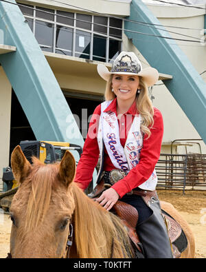 Cara Spirazza, 2019 Miss Rodeo Florida portrait on her horse at a rodeo event in Montgomery Alabama, USA. - Stock Image