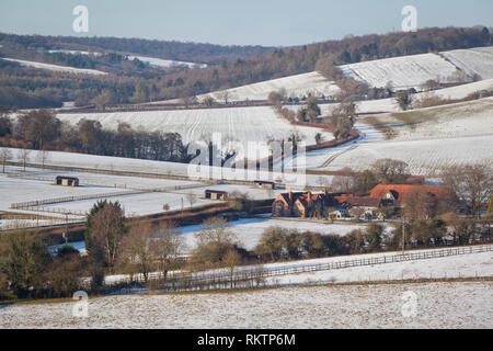 A winter scene over farmland near Fingest with snow on the ground. - Stock Image