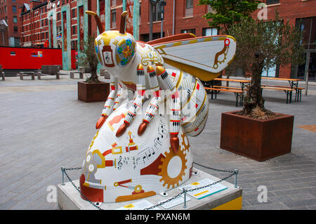 Hallé St. Bee-ter's: A Chorus of Industry, by Daniel Gubba.  One of the Bee in the City sculptures, Cutting Room Square, Ancoats, Manchester, UK. - Stock Image