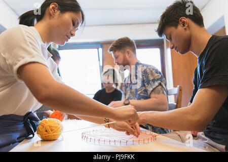 People making string art project - Stock Image