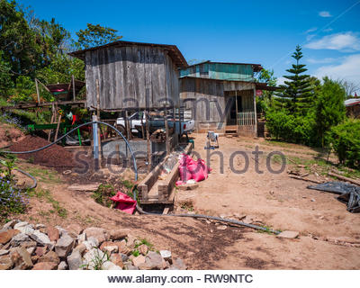 Coffee finca in Jinotega Department with wet processing vats under a wooden building.  Farmhouse in rear for workers. - Stock Image