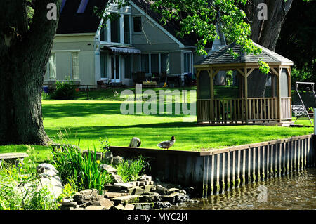 House on river with gazebo. - Stock Image
