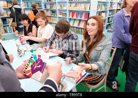 Hay Festival, Hay on Wye, Powys, Wales, UK - Friday 31st May 2019 - YA author Juno Dawson signing copies of Proud in the Festival bookshop.  Photo Steven May / Alamy Live News - Stock Image