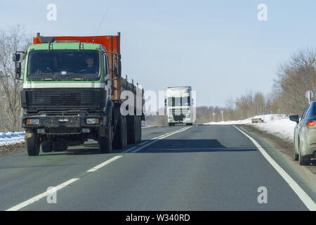 Big Truck rides on the road. Truck transportation - Stock Image