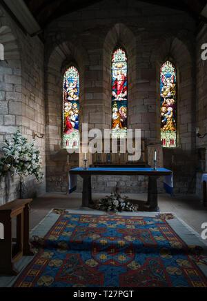Lindisfarne or Holy Island, Northumberland coast south of Berwick-on-Tweed, England. Parish church of St Mary the Virgin. Altar. - Stock Image