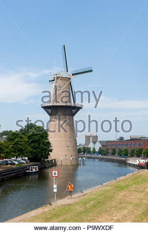 Schiedam The Netherlands  Noletmolen windmill, claimed to be the highest in the world. Similar to wind turbines the windmill is used to generate elect - Stock Image