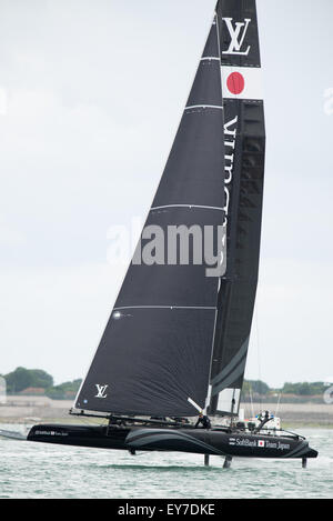 Portsmouth, UK. 23rd July 2015. SoftBank Team Japan is one of the first AC45f catamarans to foil during the Parade - Stock Image