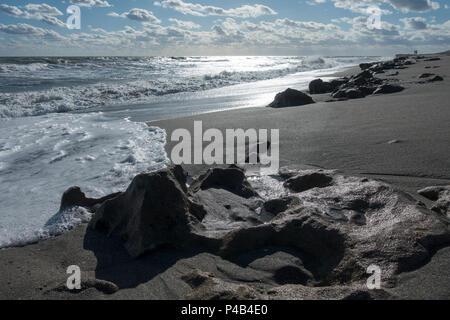 Ocean waves erode ancient coral reef, Blowing Rocks Preserve, Jupiter, Florida, USA - Stock Image