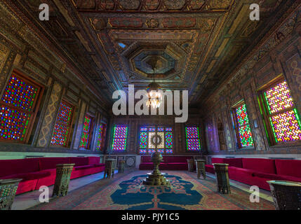 Manial Palace of Prince Mohammed Ali - Open for public. Syrian Hall with ornate wooden wall and ceiling, windows with colored stained glass - Stock Image