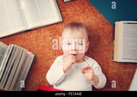 One year old baby with books - Stock Image