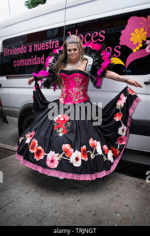 Posed portrait of a trans marcher in costume at the 2019 Queens Pride Parade in Jackson Heights, NYC. - Stock Image
