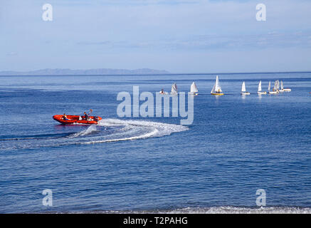 Motorboat and sailing boats. Almeria, Andalucia, Spain. - Stock Image
