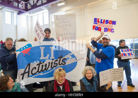 Westbury, USA. January 15, 2017.  LI Activists group members bring a large banner and signs to the 'Our First - Stock Image