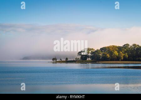 Early morning mist desending on Lough Erne - Stock Image