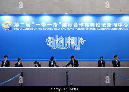 (190423) -- BEIJING, April 23, 2019 (Xinhua) -- Photo taken on April 23, 2019 shows the Information Desk of the Media Service Area in the Media Center for the second Belt and Road Forum for International Cooperation in Beijing, capital of China, on April 23, 2019. The media center started trial operation at the China National Convention Center in Beijing Tuesday. More than 4,100 journalists, including 1,600 from overseas, have registered to cover the second Belt and Road Forum for International Cooperation to be held from April 25 to 27 in Beijing. (Xinhua/Zhang Chenlin) - Stock Image