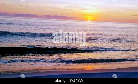 Scenic View Of Sea Against Dramatic Sky During Sunset - Stock Image