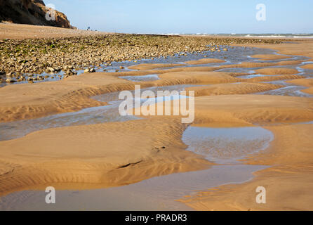 A view of beach patterns on the North Norfolk coast at East Runton, Norfolk, England, United Kingdom, Europe. - Stock Image
