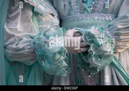 Venice, Italy. 25th Feb, 2014. A detail image of costumed hands holding each other and a pale green rose. Venice Carnivale Credit:  MeonStock/Alamy Live News - Stock Image