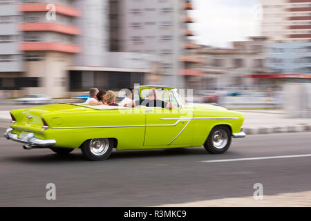Cuba, Havana. Lime green classic convertible in motion. Credit as: Wendy Kaveney / Jaynes Gallery / DanitaDelimont.com - Stock Image