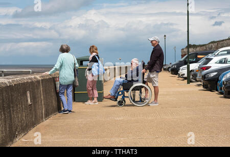 Old people with a man in a wheelchair - Stock Image