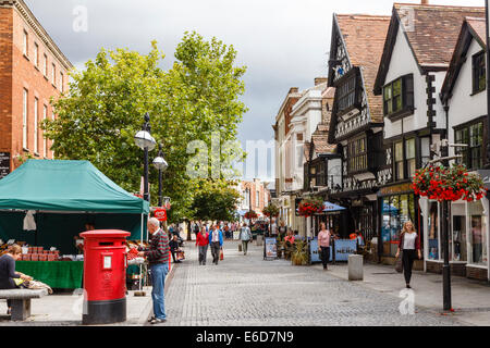 High Street in Taunton. Man standing beside double post box. Grade 1 listed Tudor building, 1568, is currently a - Stock Image