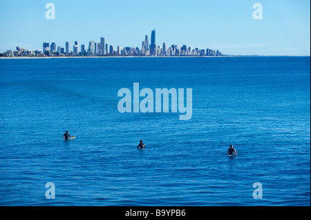 Surfers waiting for a wave on the Gold Coast - Stock Image