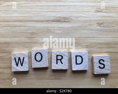 Words, in wooden letters isolated on a bamboo board background with copy space - Stock Image