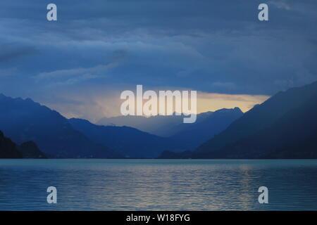 Sunset view from Brienz. Thunderstorm arriving over Interlaken, Switzerland. - Stock Image