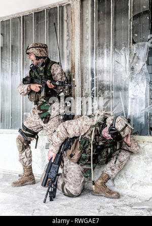 Marines assault team under intensive enemy fire. - Stock Image