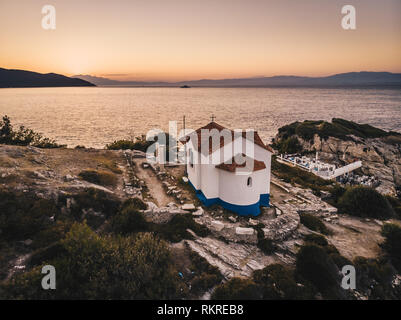 Sunset in Thasos island overlooking Thasos Town and harbour ath the Two Apostles Church - Stock Image