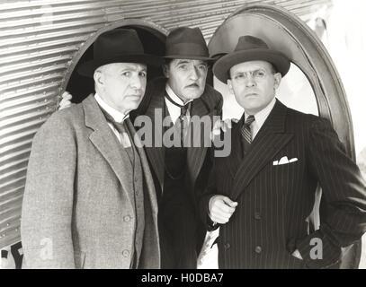 Three curious men - Stock Image