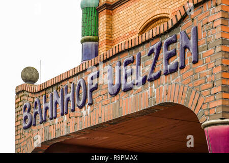 Uelzen, Germany, December 21., 2018: Inscription above the entrance of the Uelzen railway station, executed with round dark blue tiles according to Hu - Stock Image