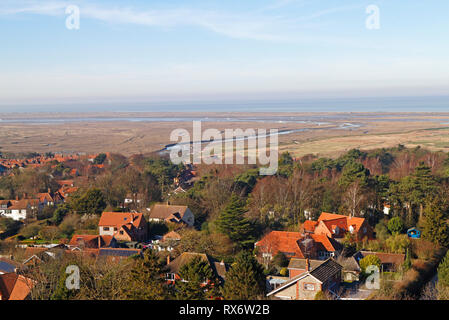 A view over Blakeney village to the salt marshes and Blakeney Point from the Church tower at Blakeney, Norfolk, England, United Kingdom, Europe. - Stock Image