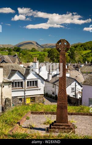 UK, Cumbria, Hawkshead, elevated view of village from Celtic Cross WW2 War Memorial in St Michaels Parish Churchyard - Stock Image