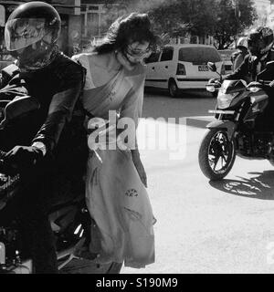 Bridesmaid on a motorbike - Stock Image