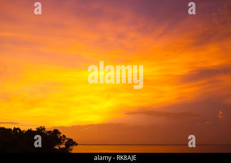 Orange sunset over Darwin Harbour in Darwin, Northern Territory, Australia. - Stock Image
