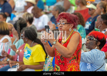 Detroit, Michigan - A woman uses her cell phone to film the action during Senior Friendship Day, an event that brought several thousand senior citizen - Stock Image