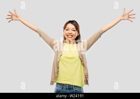 happy asian woman celebrating success - Stock Image