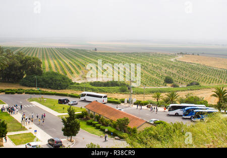 The fertile Valley of Jezreel taken from the historic Tel Megiddo in Lower Galilee Israel. Te car park for visitors to the Tel Megiddo is in the  fore - Stock Image